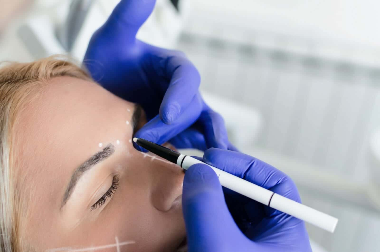 Doctor doing preparations for botox procedure on woman